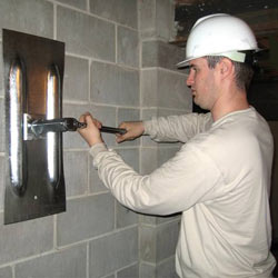 installing a wall anchor to repair an bowing foundation wall in Mount Airy