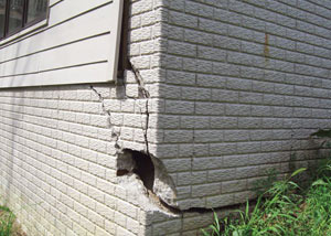A severely damaged foundation wall in Reidsville