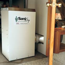 A basement dehumidifier with an ENERGY STAR® rating ducting dry air into a finished area of the basement  in Elon